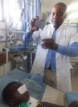 First RD, nutrition expert, in Malawi mixing a formula at bedside